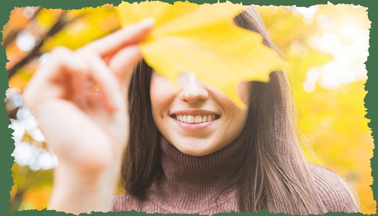 Femme feuilles automne booster défenses